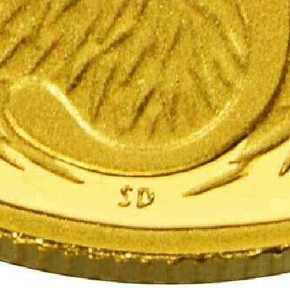 The initials of the designer, Stuart Devlin (SD), on the 2012 Proof Five Cent (Miniature) piece.