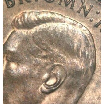Missing hairline detail on the obverse of a 1940 half penny