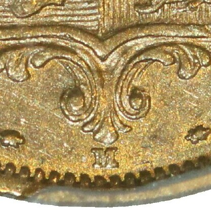 Melbourne Mint 'M' mintmark directly below the shield and between two rosettes.