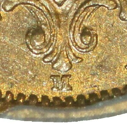 Reverse: Melbourne mint 'M' mintmark directly below the shield and between two rosettes