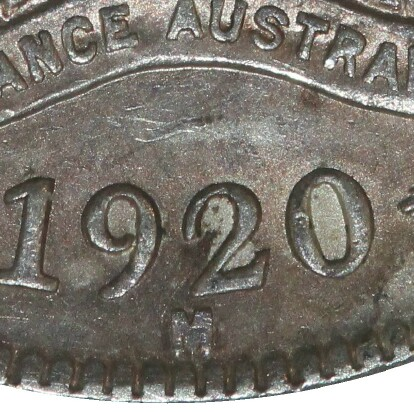 Melbourne 'M' mint-mark on the reverse of a 1920-M Shilling.