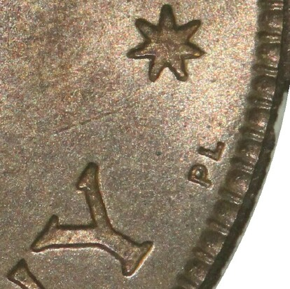 London 'PL' mint-mark on the reverse of a 1951-PL Half Penny.