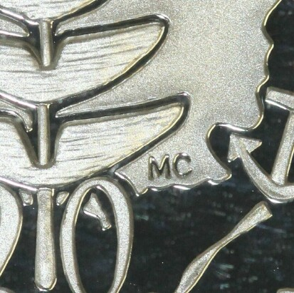 Artist Megan Cummings initials (MC) on the 2001 Proof (Norfolk Island) Twenty Cent piece.