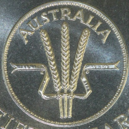 The internal coin design on the obverse of the 2016 ten cent (50 Years of Decimal Currency) piece with the initials of designer Kruger Gray (KG) located on either side of the wheat stalks.