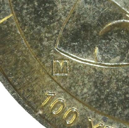 M privy-mark on 2010-M (Coin Centenary) one dollar piece.