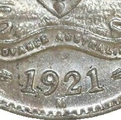The M mintmark beneath the date on a 1921M threepence