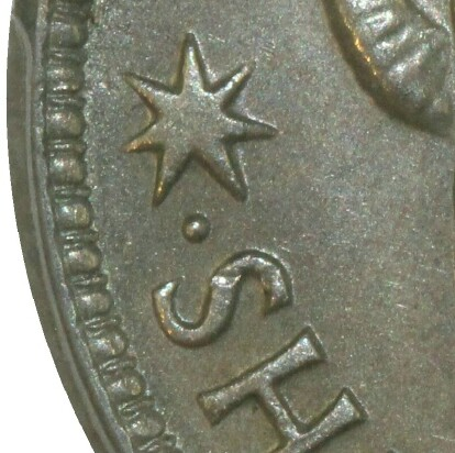 Dot mint-mark on the reverse of a 1946-P Shilling.