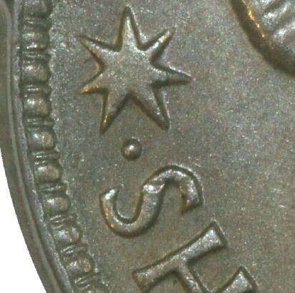 Perth dot mint-mark on the reverse of a 1946-P Shilling.