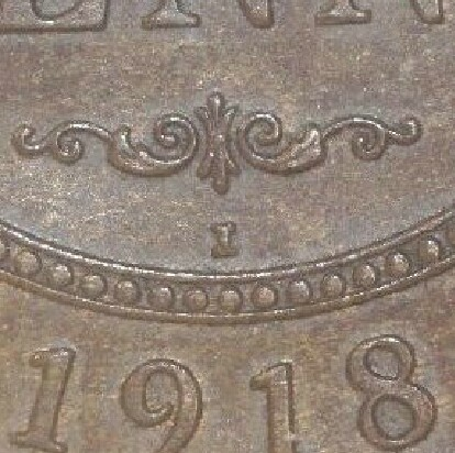 India 'I' mint-mark on the reverse of a 1918-I Penny.