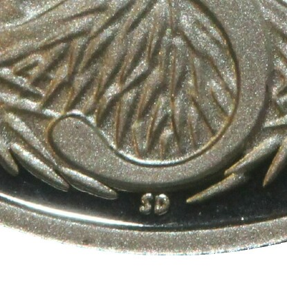 The initials of the designer Stuart Devlin (SD) on a 2001 Proof Five Cent piece.