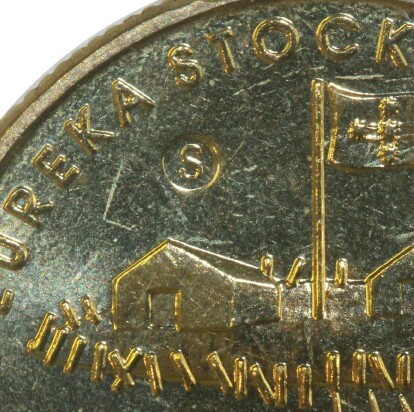 An 'S' counter-stamp from the Ballarat Eureka Centre on this 2004 One Dollar (Eureka) piece.