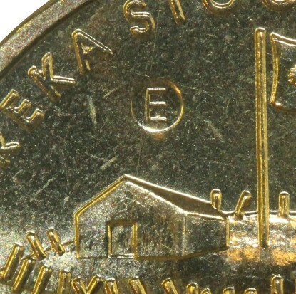 An 'E' counter-stamp from the Ballarat Eureka Centre on this 2004 One Dollar (Eureka) piece.