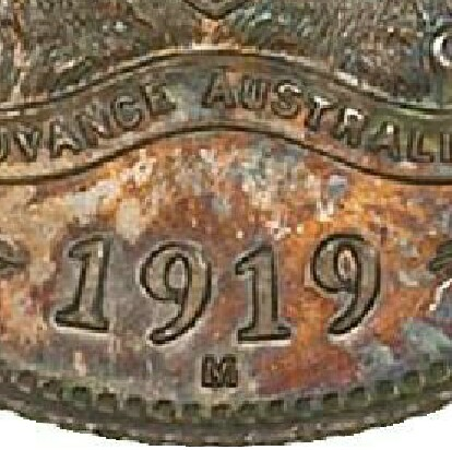 Melbourne 'M' mint-mark on the reverse of a 1919-M Specimen Sixpence.
