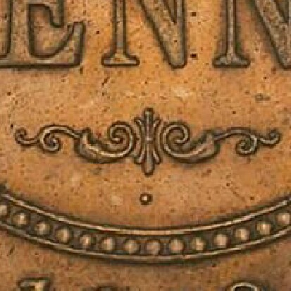 Example of the 'dot below' on a 1919 Dot Below Proof Penny.