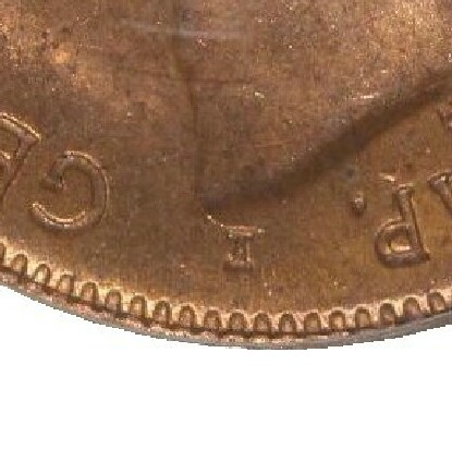 The mintmark I under King George V on the obverse