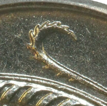 Four spurs along the bottom of the central feather indicate this 1966 Ten Cent was minted in Canberra.