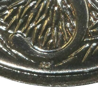The initials of the designer Stuart Devlin (SD) on a 1987 five cent piece.