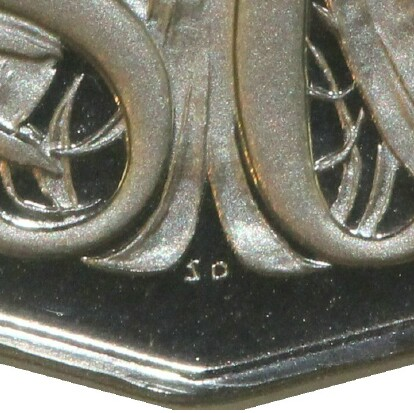 Initials of artist Stuart Devlin (SD) on a 1974 Proof Fifty Cent piece.
