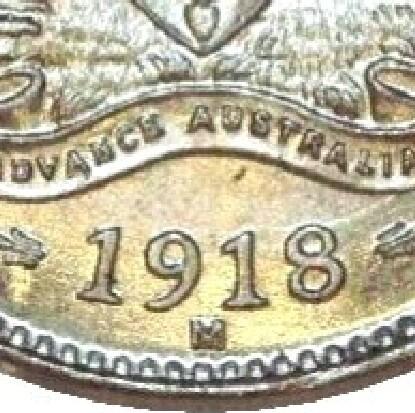 M mintmark of a 1918-M threepence