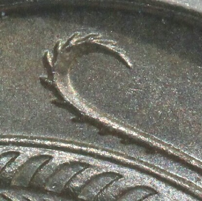 Five spurs along the bottom of the central feather indicate this 1966 Ten Cent was minted in London.