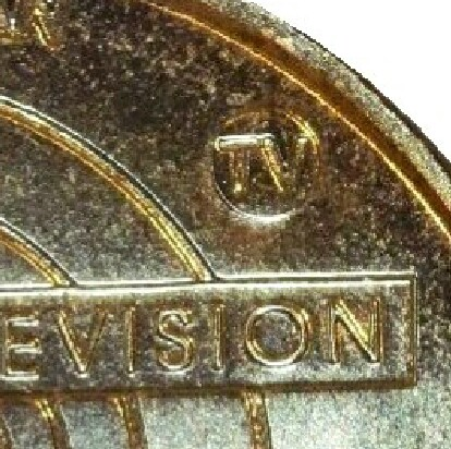TV mint-mark on 2006-TV (50 Years of Television) one dollar piece.