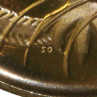 The initials of the designer, Stuart Devlin (SD), on a 1966 Proof One Cent piece.