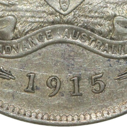 No mint-mark on a 1915 Florin struck at the Royal Mint in London.
