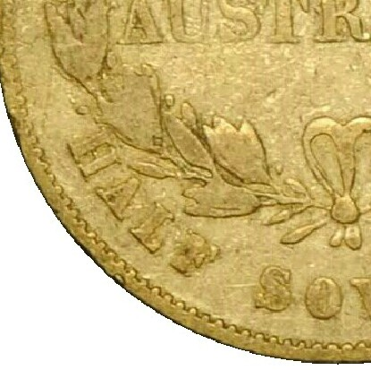The Alternate Reverse lacks the berry above L of HALF