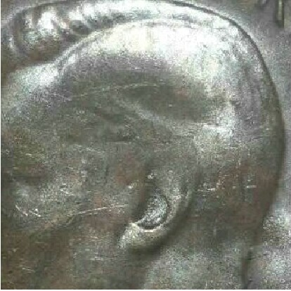 A characteristically soft bust of a 1948 Perth mint half penny