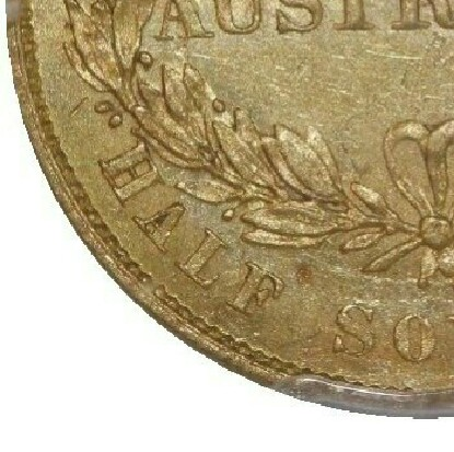 The 1856 Standard Reverse has a berry above L of HALF