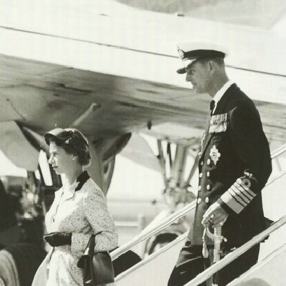 Her Majesty Queen Elizabeth II and the Duke of Edinburgh stepping from their plane at Essendon airport (Melbourne) in 1954.