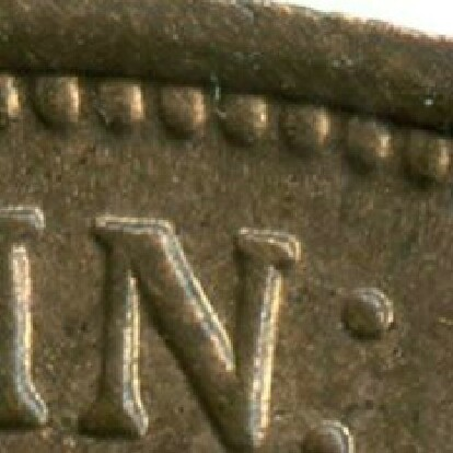 Last stroke not aligned with border bead on the London reverse.